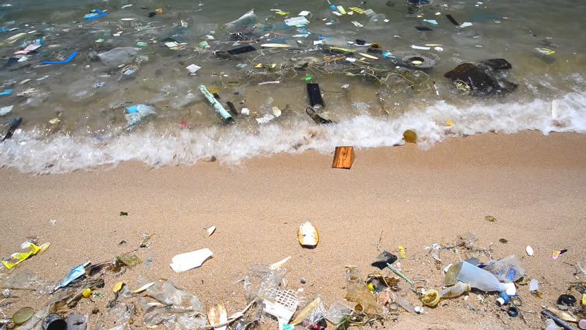 Pollution on the beach of tropical sea.