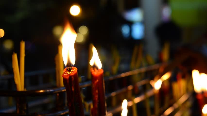 Golden light of candle flame   Shutterstock HD Video #9558638