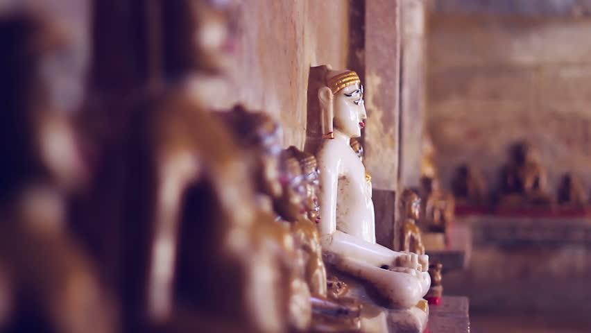 Sacred sculptures of a Jain temple in Jaisalmer, Rajasthan, India. Shallow depth-of-field.