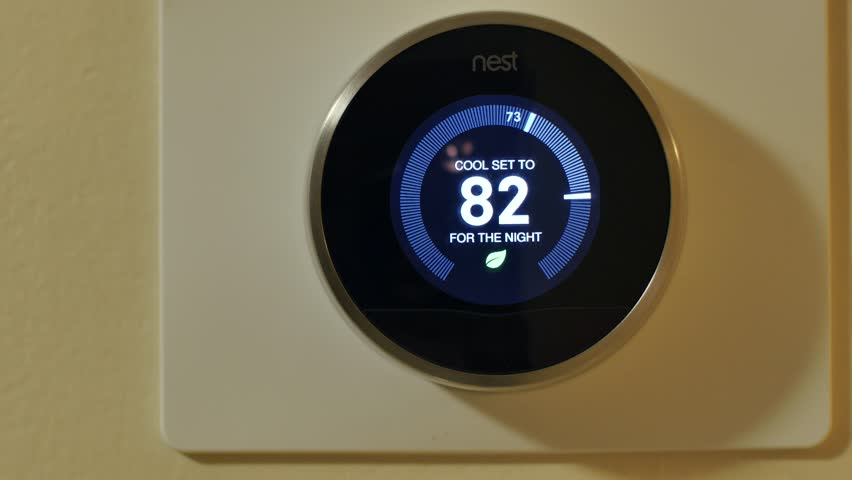 MIAMI - APRIL 6, 2015: Video of the Nest wifi learning thermostat making automatic temperature adjustments via smartphone April 6,2015 in Miami FL