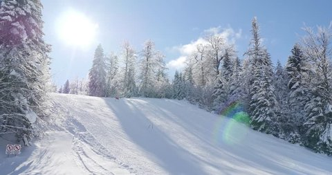 Footage of a winter scene with a skier skiing downhill/Enjoying my holiday