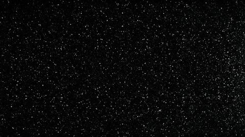 Twinkling flares in 4K UHD video. Black space and white stars, imitation. Use for background and texture.