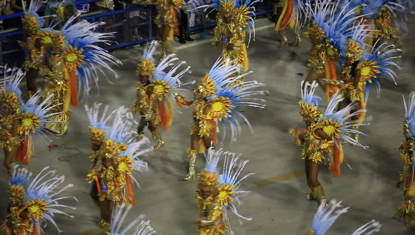 RIO DE JANEIRO, BRAZIl - FEBRUARY 16, 2015: Participants in the Carnival present their costumes during the Carnival, February 16, 2015 in Rio de Janeiro (Brazil) | Shutterstock HD Video #9576656