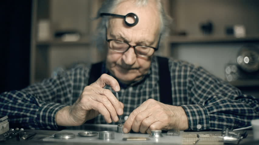 Dolly of watchmaker busy with his work