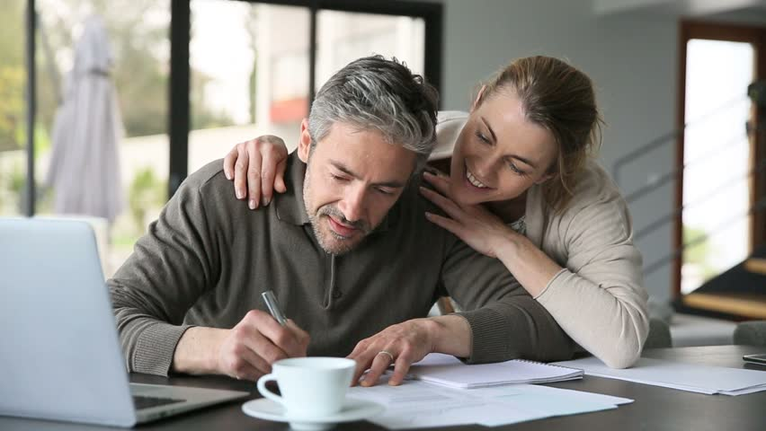 Woman embracing man while working on latptop at home   Shutterstock HD Video #9598337