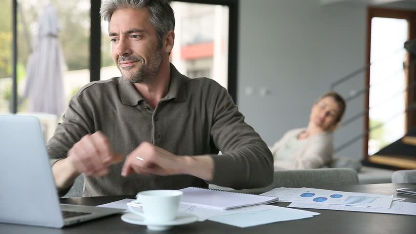 Man drinking coffee in front of laptop at home | Shutterstock HD Video #9598340