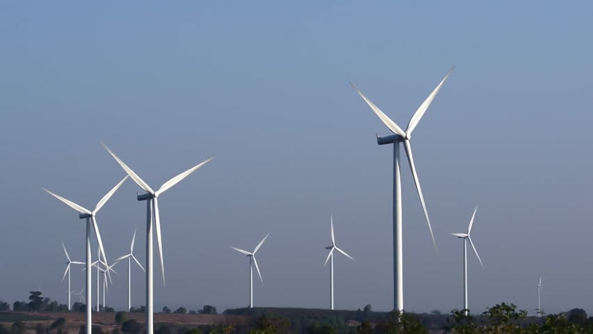 Wind turbine rotating smoothly in the early morning with blue sky background. | Shutterstock HD Video #9604250