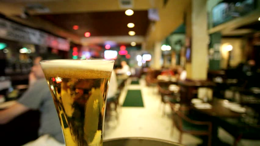 Beer traveling through a bar