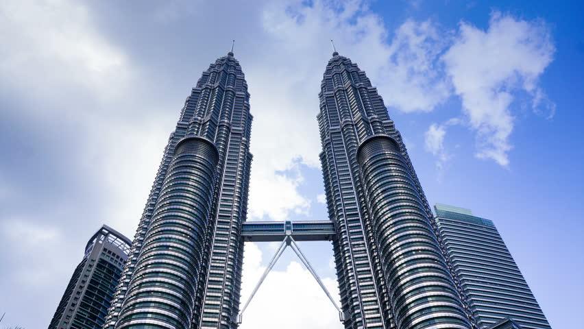 KUALA LUMPUR - APRIL 16: Time lapse of clouds over Petronas Twins Tower, Kuala Lumpur, Malaysia on April 16, 2015. Petronas Twins Tower is one of the tallest building in the world.