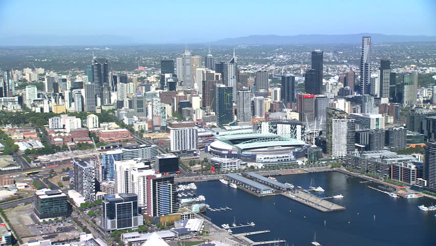An aerial shot of Melbourne City, along the Yarra River towards Docklands and Etihad Stadium on a sunny blue sky summer day.