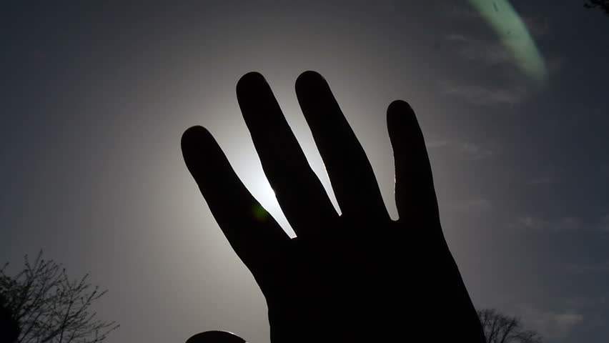 Hand in front of sun, lots of flare | Shutterstock HD Video #9638390