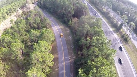 Chevrolet C ten gold pickup hot-rod truck driving on the forest road. Aerial footage.