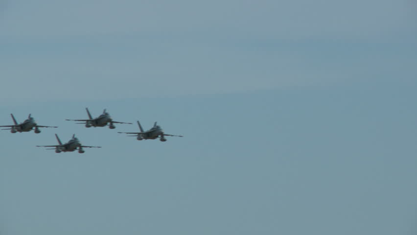 Hornet formation passing left to right