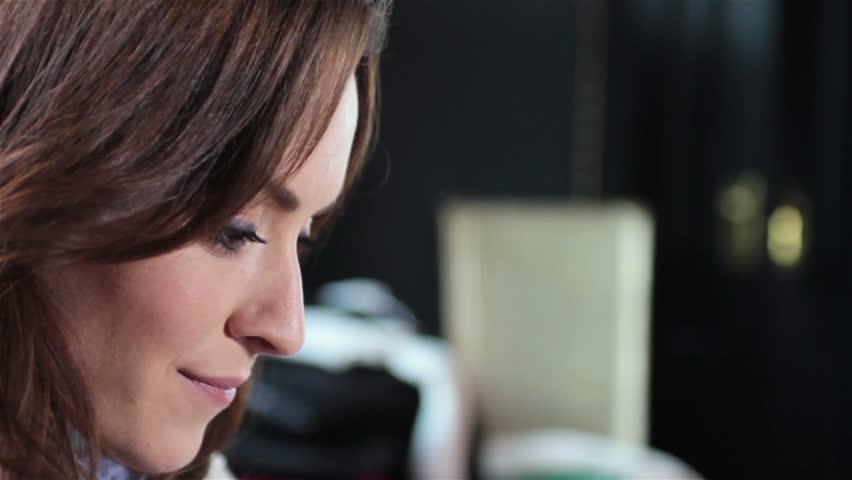 Attractive young woman enjoying a fresh cake | Shutterstock HD Video #9690350
