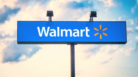 MIAMI, FL - April 22, 2015: (Timelapse) Walmart sign with time lapse clouds and sky on April 22, 2015. Walmart is an American multinational retail corporation with a chain of department and warehouse stores.