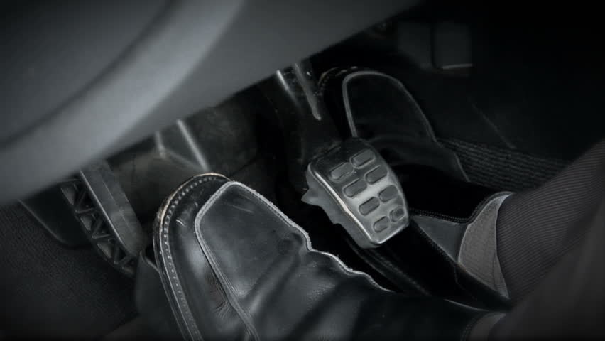 Woman Driver Press With Her Feet Car Pedals Clutch