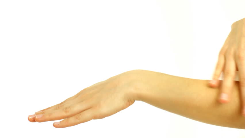 Closeup of beautiful female hands applying hand cream