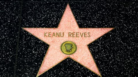 HOLLYWOOD, CA/USA - APRIL 18, 2015: Keanu Reeves star on the Hollywood Walk of Fame. The Hollywood Walk of Fame is made up of brass stars embedded in the sidewalks on Hollywood Blvd.