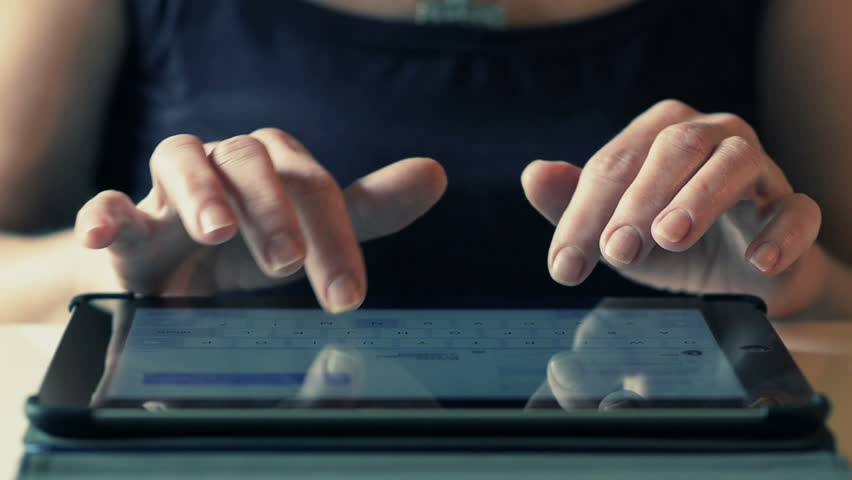 Close-Up Woman Typing On IPad | Shutterstock HD Video #9763271