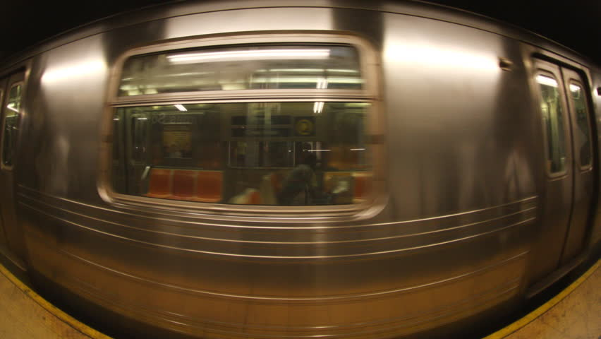 NEW YORK - APRIL 16: fisheye of a new york subway train coming into the station, New York , United States. APRIL 16, 2009. (Time Lapse)