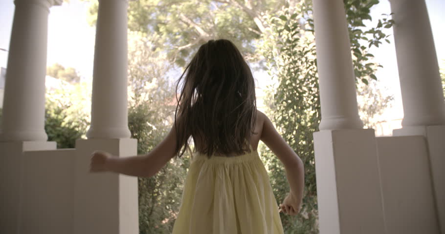 Rearview of a little girl running happily towards an open front door with vintage feel, Panning in Slow Motion | Shutterstock HD Video #9791717