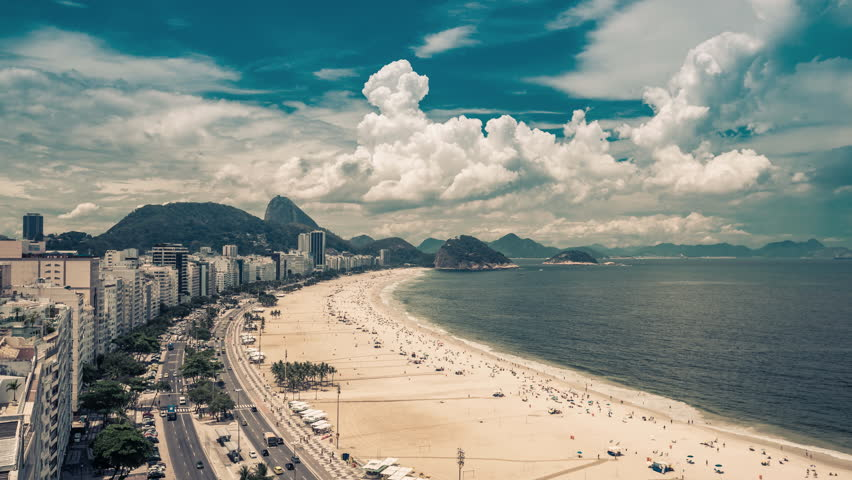 Copacabana Beach high angle street Time Lapse in Rio de Janeiro, Brazil. Clouds rolling dynamic with vintage colors.