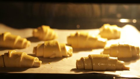 Time-lapse video of croissants baking in oven