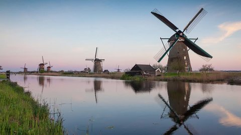 Famous Kinderdijk mills on the water channel. Netherlands, Europe. Unesco world heritage site. Exported from RAW file.