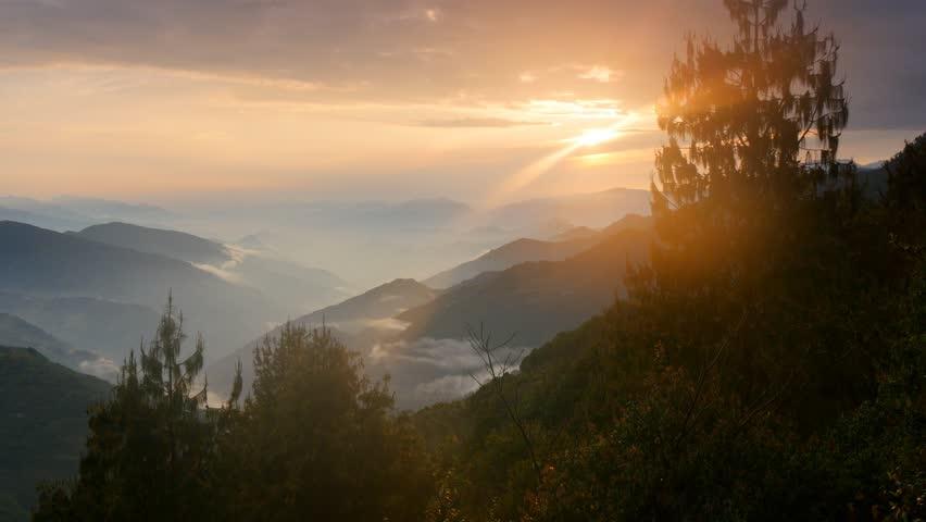 Foggy Himalayas mountains at sunset lights. Nepal, Langtang national park. UHD, 4K | Shutterstock HD Video #9866429