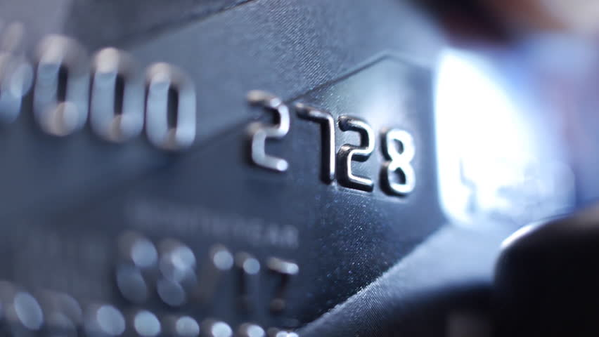 Credit Card swipe through PIN Terminal. Extreme closeup. Shallow depth of field | Shutterstock HD Video #9913883