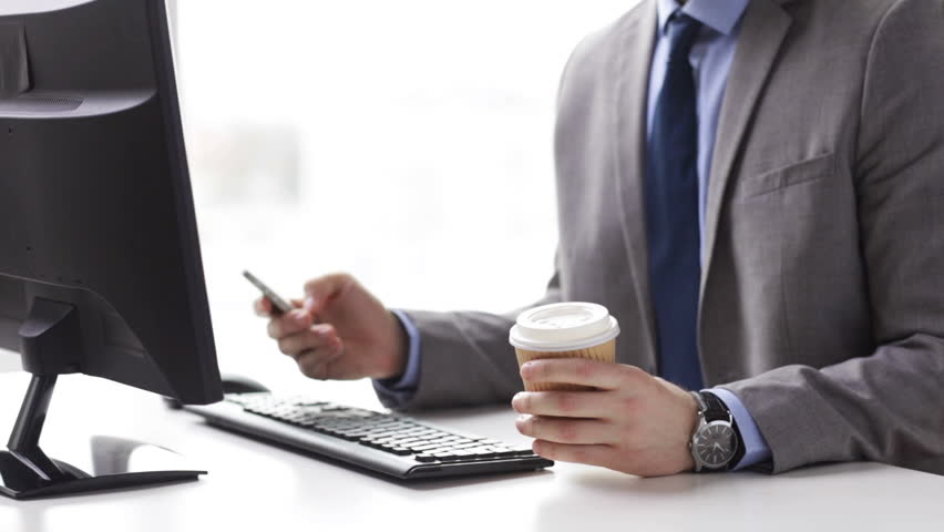 People, business, technology and office work concept - close up of businessman with smartphone drinking coffee | Shutterstock HD Video #9914180
