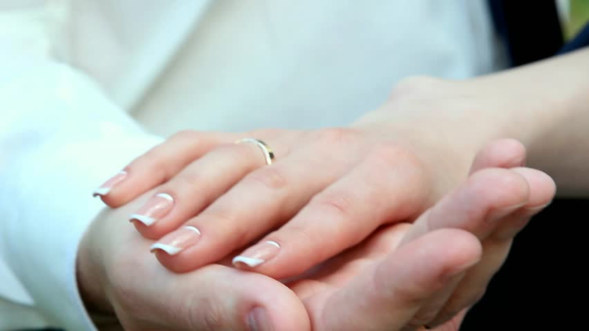 Wedding rings groom and bride with wedding ring hands of wedding hands of a wedding heterosexual couple with wedding rings on fingers groom and bride junglespirit Images