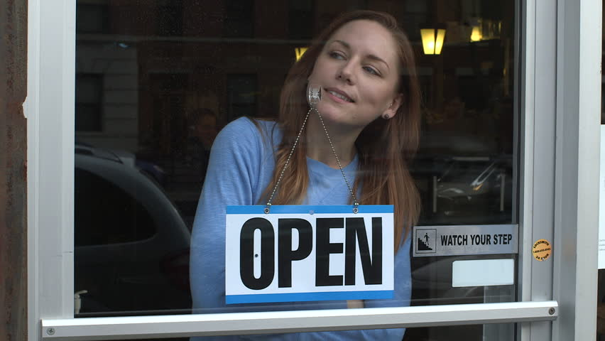 A young woman opens a store for business in New York City   Shutterstock HD Video #9932570