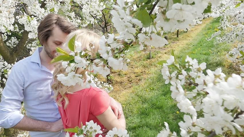 Happy couple having fun in garden - slow motion   Shutterstock HD Video #9934940