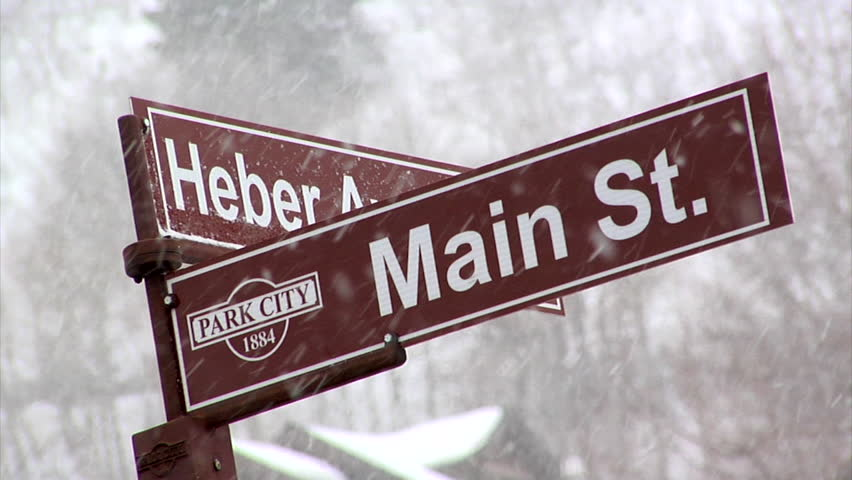 park city utah circa january 2015 snow falling on traffic sign on main - Glass Front Cafe 2015