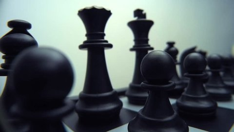 Chess Board and Pieces. Move camera above the chessboard. Closeup. Shallow depth of field. Dolly shot