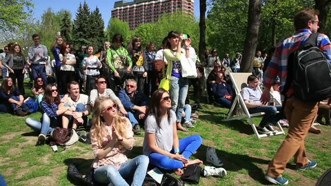 """MOSCOW, RUSSIA - MAY 09, 2015: Fans dancing and applauding. Festival of marching bands in the city Park """"Muzeon""""."""